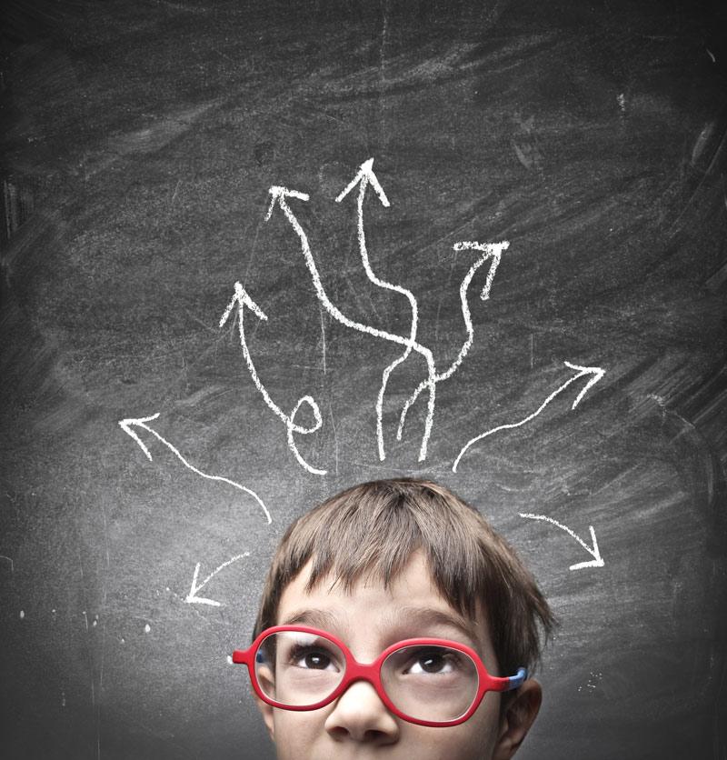 Kid-with-chalkboard-arrows-800x836