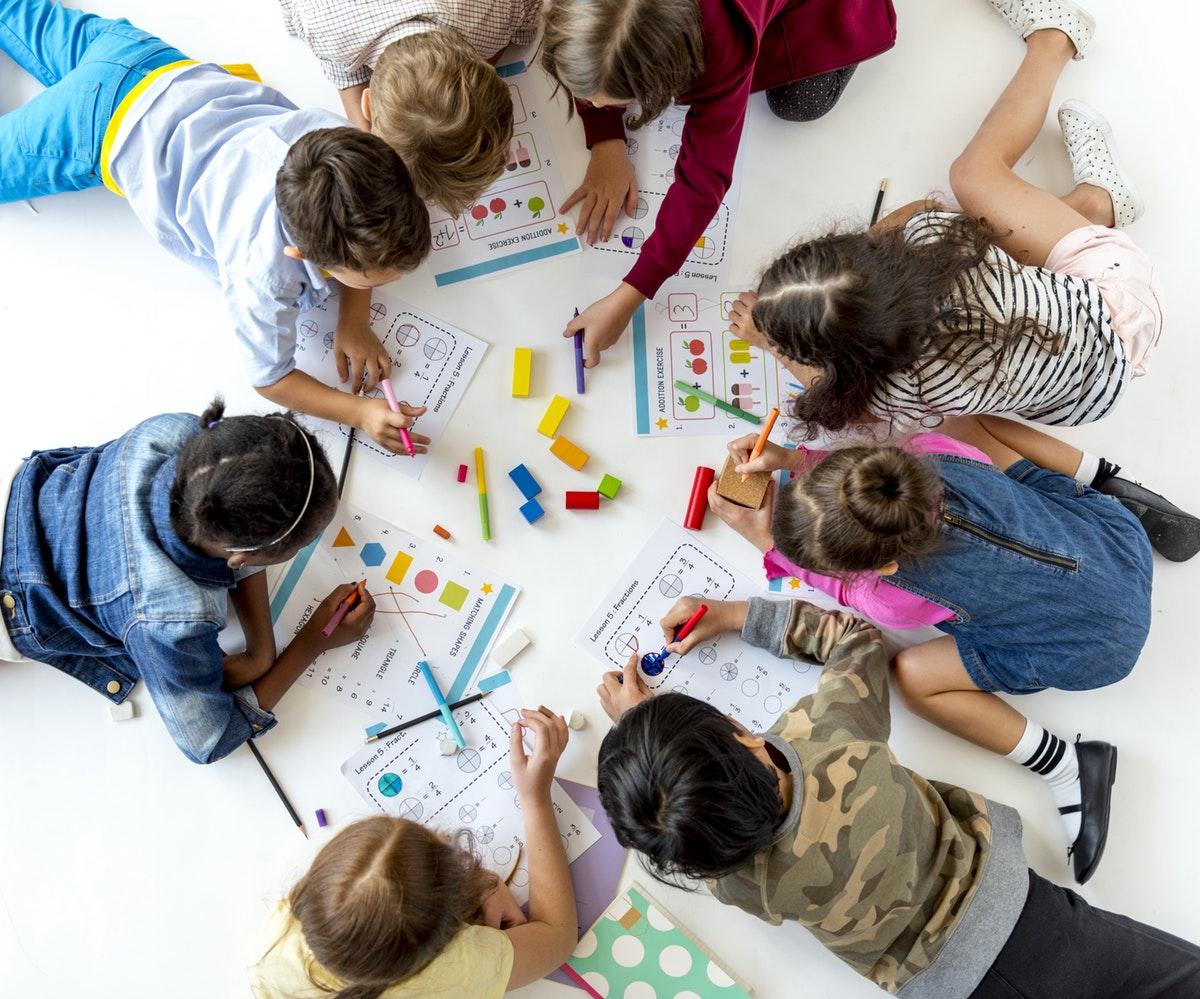 Kids doign worksheets 1200x999